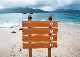 wood sign with ocean background photo