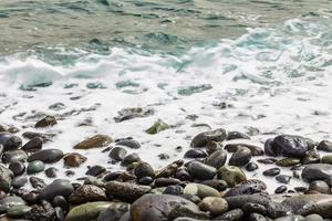 Stone ocean coast with waves photo
