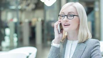 Pleasant businesswoman having a phone talk