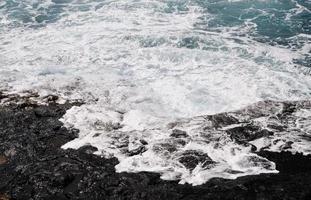 Waves over Volcanic plateau photo