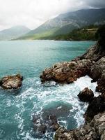 foamy wave  and  rocky photo