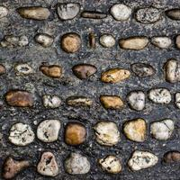 Wet pavement of natural smooth stones
