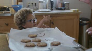 Mother and son tasting freshly baked cookies