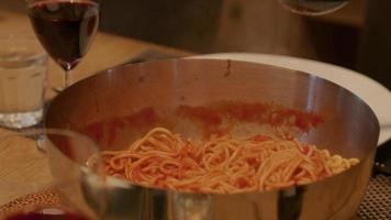 Pan of fresh spaghetti being served