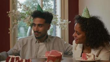 Young man with mature woman at birthday party