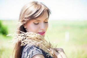 Girl in wheat photo