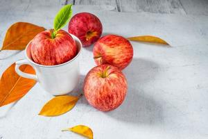 Red apples on a white wooden table photo