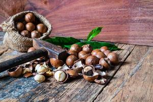 Macadamia nuts on a wooden table photo