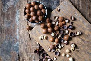 Organic Macadamia nuts on a wooden table photo