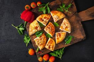 Hot pizza on wooden tray