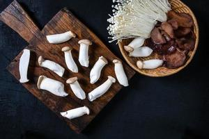 Fresh mushrooms on wood and in bowl photo