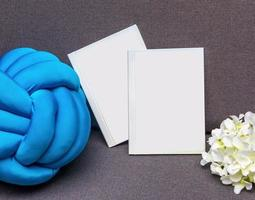 White postcard book with flower