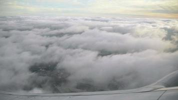 clouds from a plane window screen