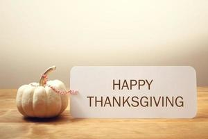 Happy Thanksgiving message with a white pumpkin photo