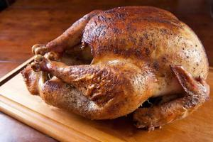 Roasted Turkey Resting on Wooden Board photo