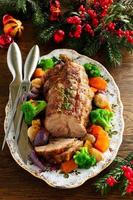 Roast pork with vegetables and spices. photo