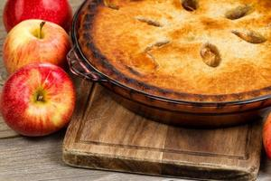 Freshly baked organic homemade apple pie on wooden server