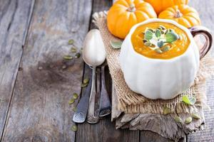 Pumpkin soup with cream, herbs and seeds photo