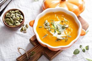 Pumpkin soup with cream, herbs and seeds