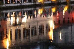 Houses reflecting in a waterway photo