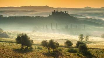 Tuscan house on the misty hills photo