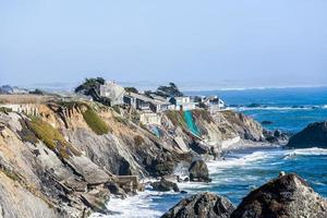 wooden houses at wild pacific coast photo