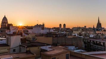 sunrise over the houses of barcelona photo