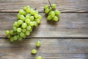 Grapes on wooden boards photo