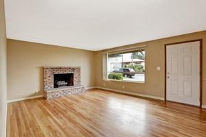 Empty house interior. Living room with fireplace photo