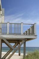 Weathered deck of beach house susceptible to heavy storms
