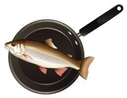 vista superior de un pescado en una sartén