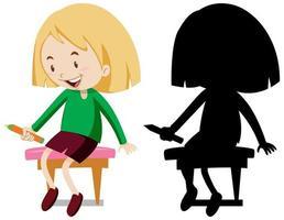 niña sosteniendo un conjunto de caracteres de lápiz