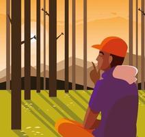 Hombre afro sentado observando el paisaje forestal