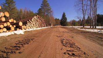 The view of the street where the logs are