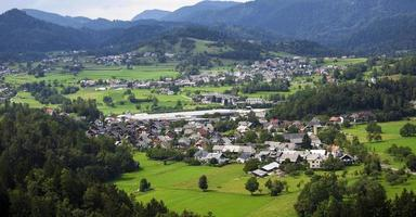 Mountain valley with green trees and houses photo