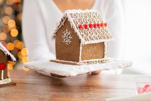 close up of woman showing gingerbread house photo