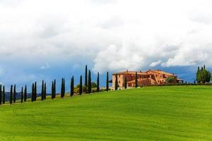 House with trees in Tuscany landscape, Italy