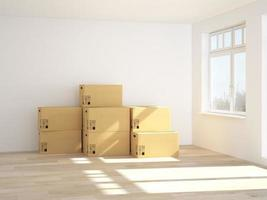 Stacked moving boxes in an empty white room photo