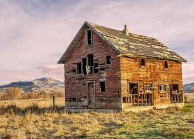 Forgotten homestead in Idaho at sunset