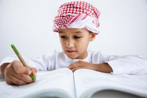 Arabic little boy doing homework