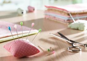 Needle pillow and scissors photo