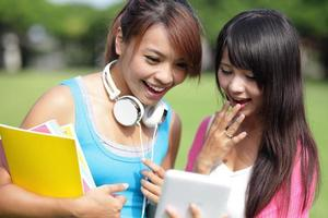 Girl students using tablet pc