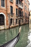 Prow of a Venetian gondola on a rainy day