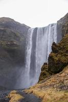 Skógafoss waterfall during rainy winter day