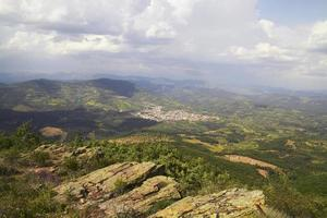 Hilltop view of Guadalupe, Spain on a cloudy day