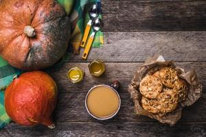 Rustic style pumpkins, soup, honey and cookies with nuts