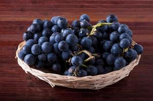 basket of black grapes