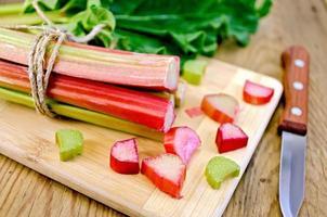 Rhubarb cut on board with sheet