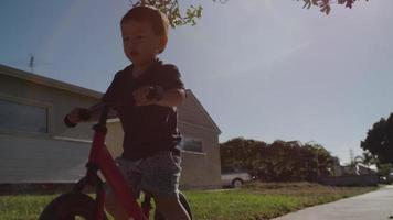 Slow motion of boy learning to ride bike