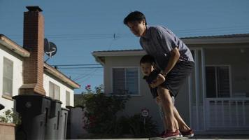 Slow motion of father and son skating on skateboard video